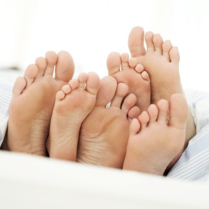Soles of a Couple and Their Child